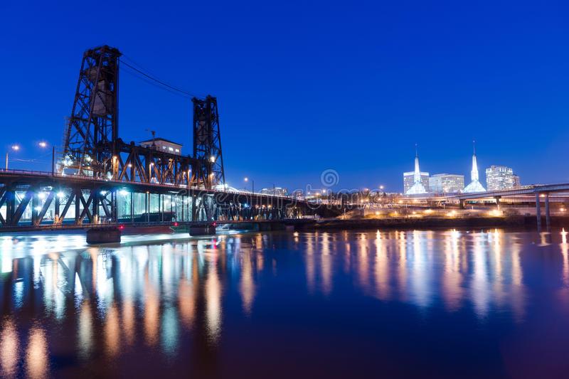 Steel Bridge Oregon Street Willamette River Downtown Portland. Water passes under the Steel Bridge in Portland with the convention center in the background royalty free stock photo