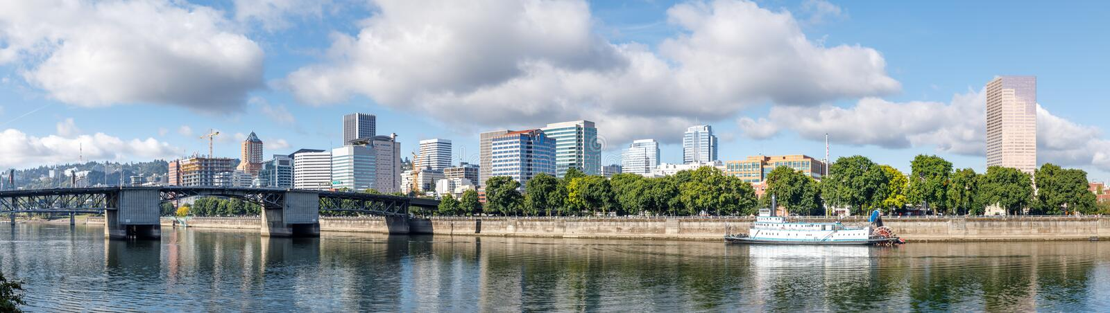 Steel bridge over water with cityscape and skyline in portland. Portland, Oregon - Sep 21, 2018 : Burnside Bridge over water with cityscape and skyline in royalty free stock image
