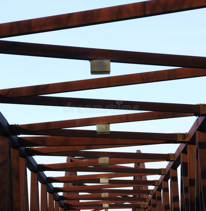 Steel bridge structure. The steel structure of a footbridge in william hawrelak park, edmonton, alberta, canada royalty free stock photography