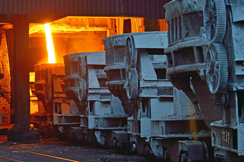 Steel buckets to transport the molten metal. Inside of plant stock photo