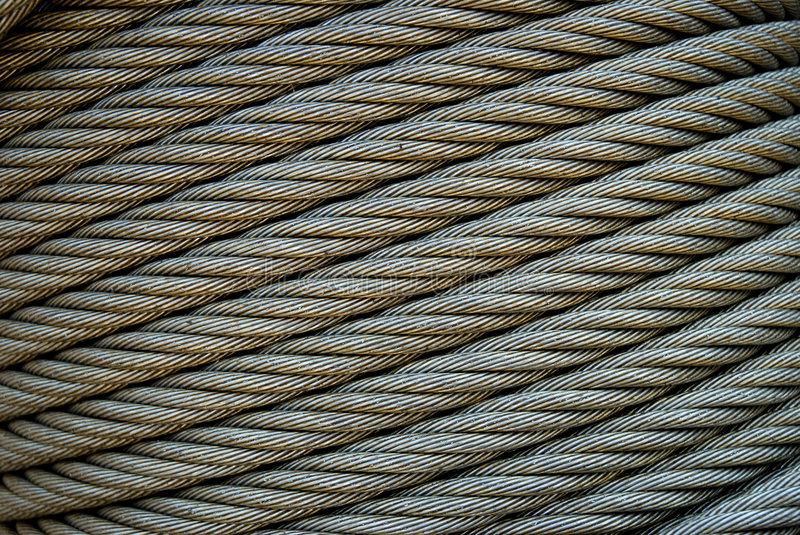 Steel Cable Diagonal. Industrial steel cable on reel with diagonal composition stock photography