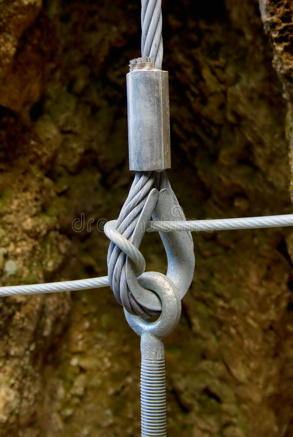 Steel cables connection. Connection of steel cables on small suspension bridge stock images