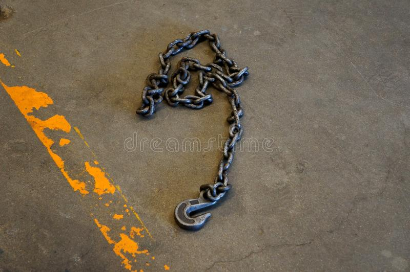 Steel chain hooks for hang heavy material in factory on the floor. Hoist chains, chain hook wheel alignment stock images
