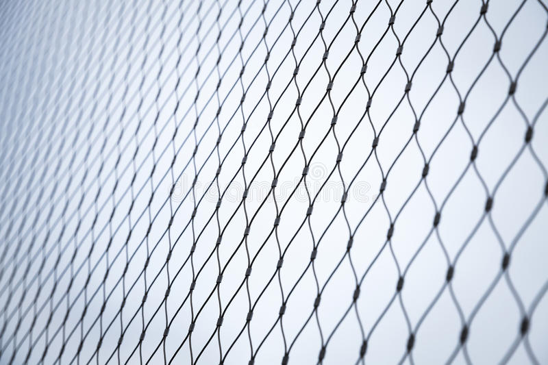 Steel chain link fence background texture. With selective focus stock image