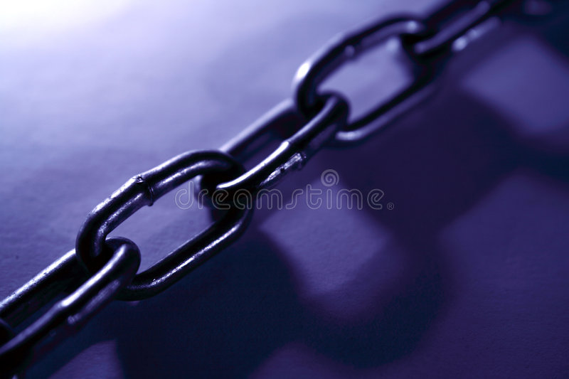 Steel chain links. Blue tone royalty free stock photos