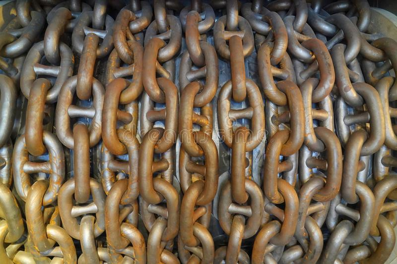 Steel chain links on a drum. Large steel chain links around a drum in a shipyard in England stock images