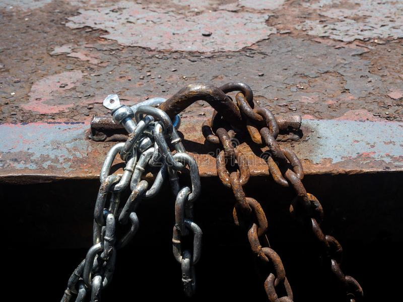 Steel chain. New steel chain and old steel chain Tie together stock image