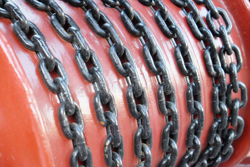The steel chain. Steel chain on reel close up royalty free stock images