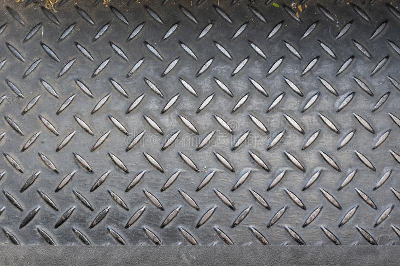 Steel checker plate anti-slip texture background on staircase step with warning safety line for failling at edge royalty free stock images
