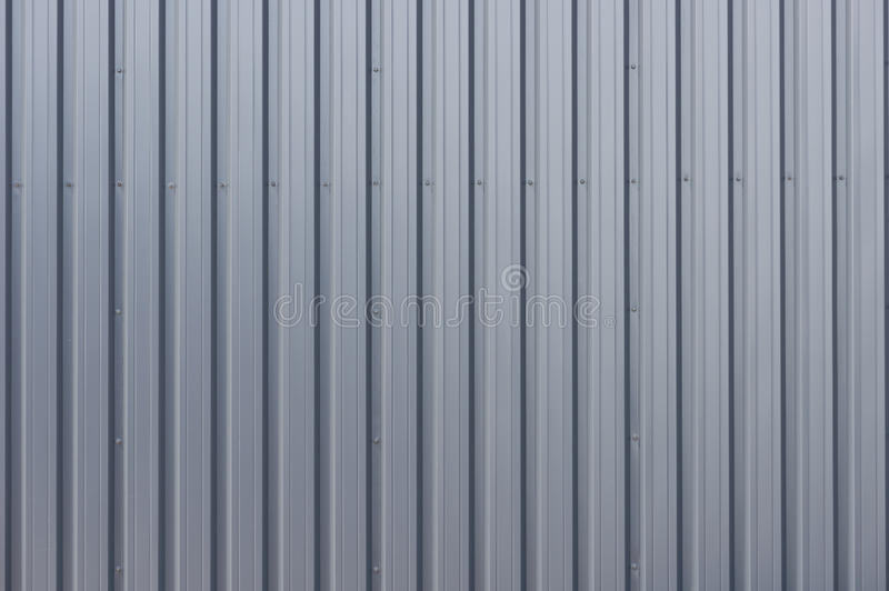 Steel cladding. Grey corrugated steel cladding on a industrial building royalty free stock photos
