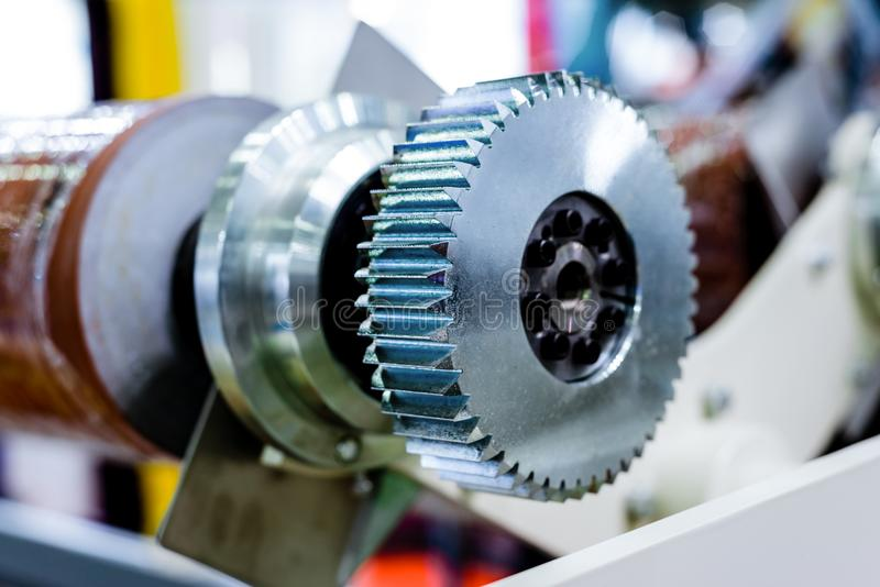 Steel cogwheel on the axle. Gear transmission of industrial machine royalty free stock photos
