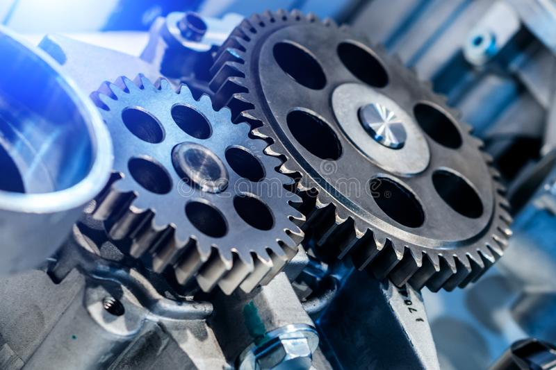 Steel cogwheels, spur gears. Steel gears and rolling bearing. Gear. Abstract industrial background royalty free stock images