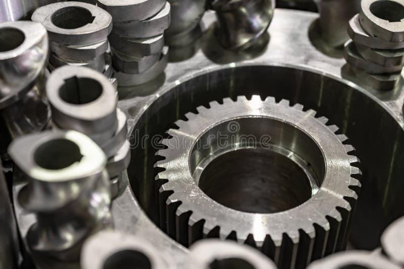 Steel cogwheels, spur gears. Steel gears and rolling bearing. Gear. Abstract industrial background stock image