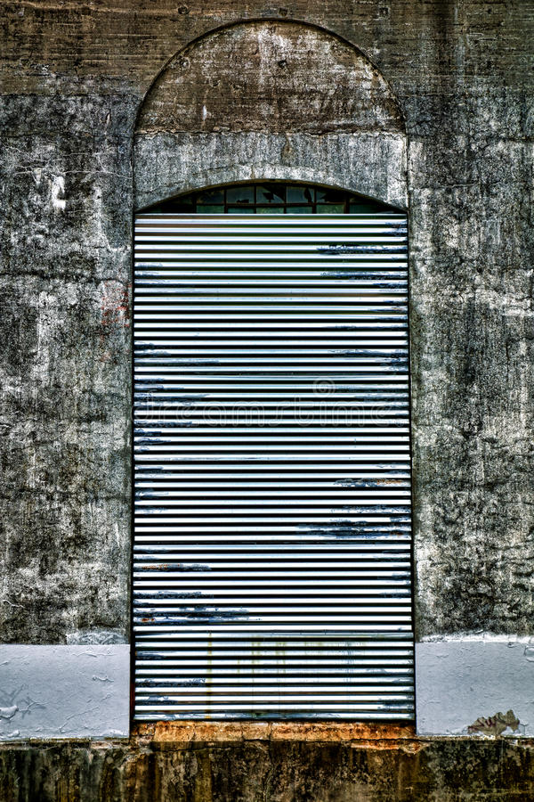 Steel Curtain Security Door on Abandoned Factory royalty free stock images