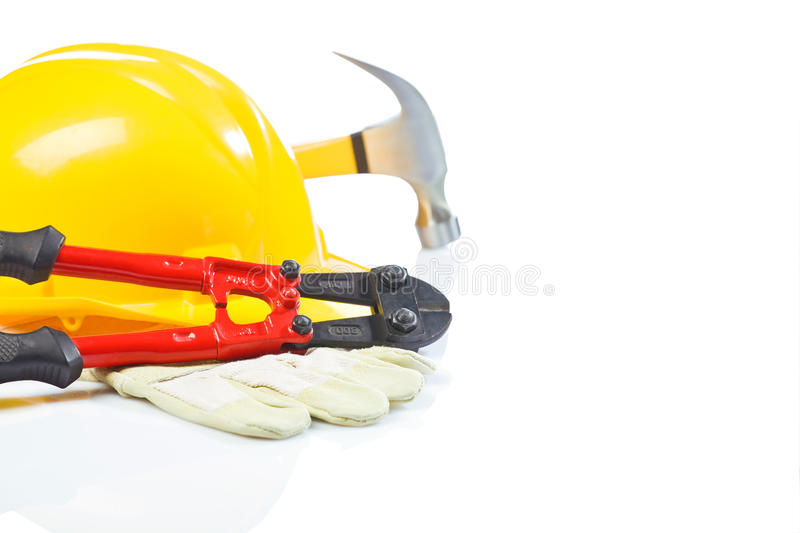 Steel cutter on glove with hardhat and hammer stock photos