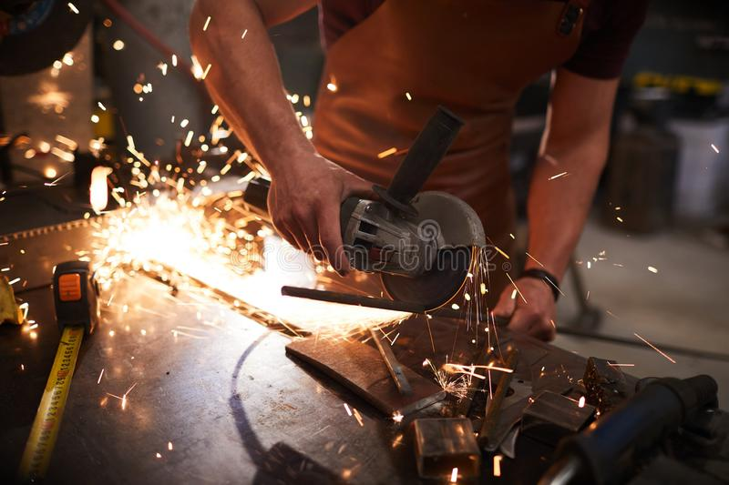 Steel cutting with grinding disc stock photography