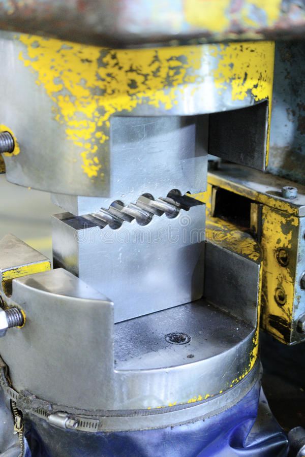 Steel die for crimping metal cables. Hydraulic Press. Steel die for crimping metal cables. Manufacture of lifting devices stock photography