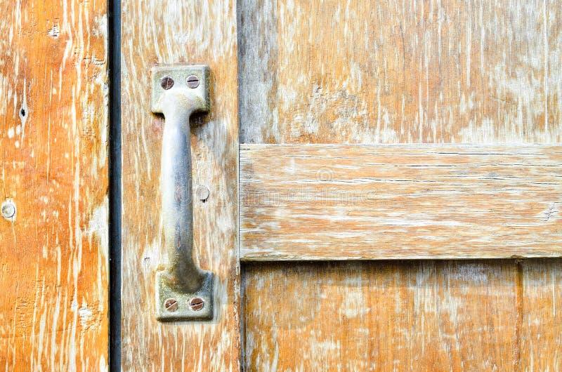 Steel door handles natural wooden door stock photography