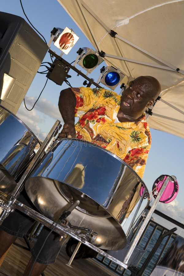 Steel Drummer Jamming. A Caribbean musician jamming on his steel drums royalty free stock photos