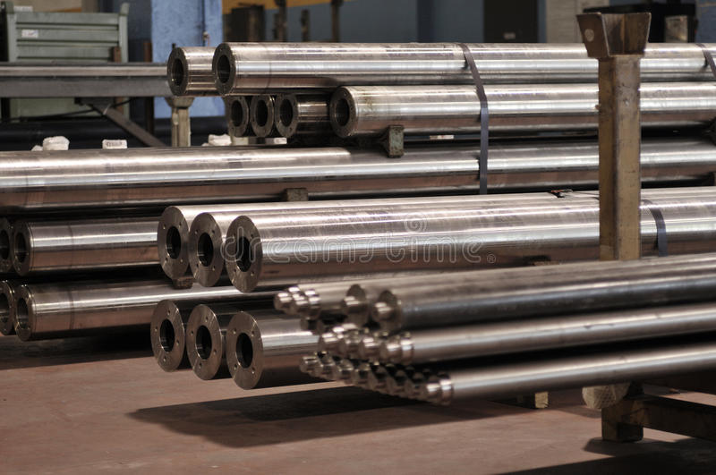 Steel fabrications. Steel fabrication, metal bars stored in warehouse royalty free stock photography
