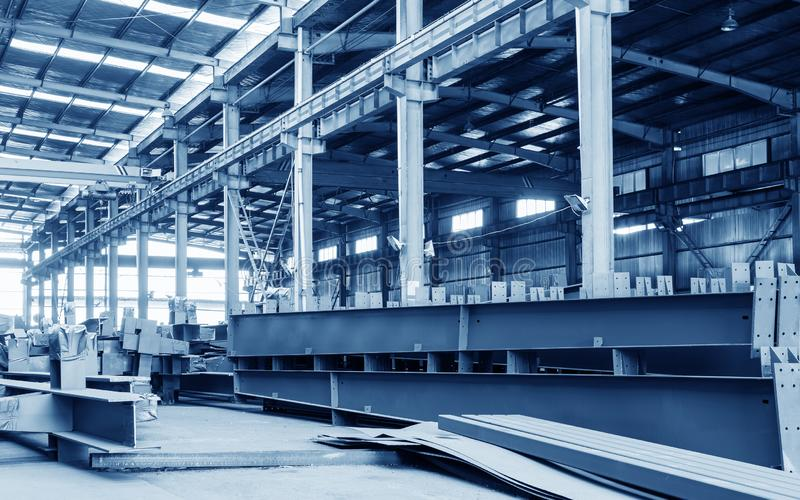 Steel factory stacked steel. Steel factory floor, stacked with a lot of steel royalty free stock image