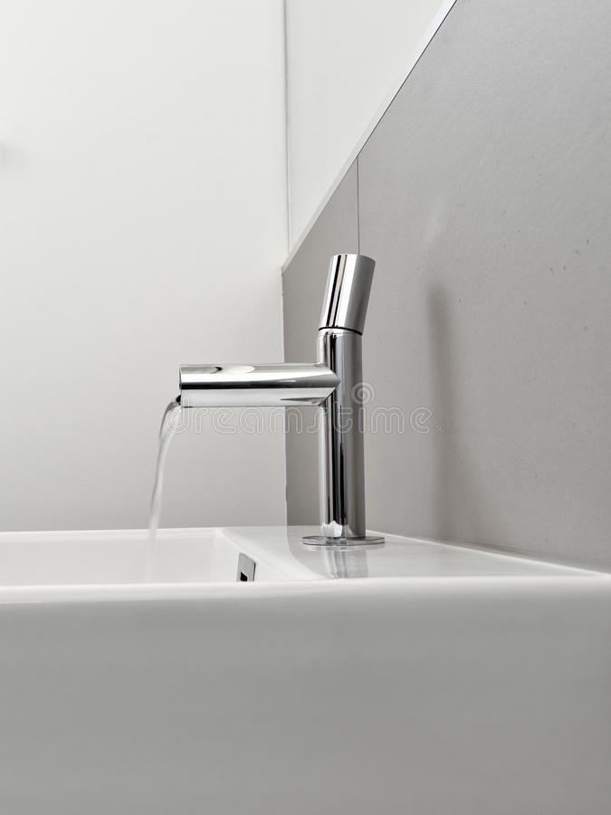 Steel Faucet In A Modern Bathroom Royalty Free Stock Photo