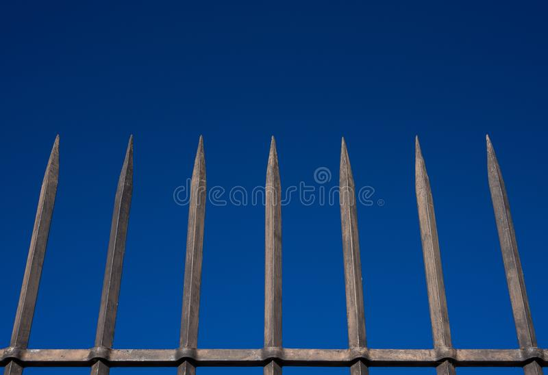 Steel bars fence with blue sky stock images
