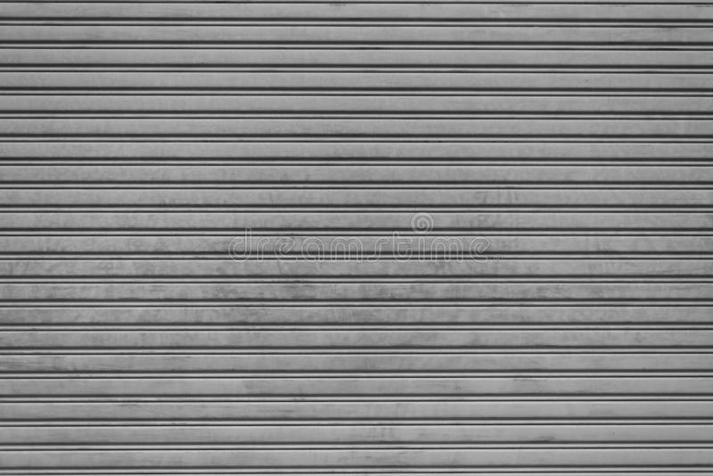 Steel folding garage shutter door background. Texture and Interior concept. Industry theme. royalty free stock photography