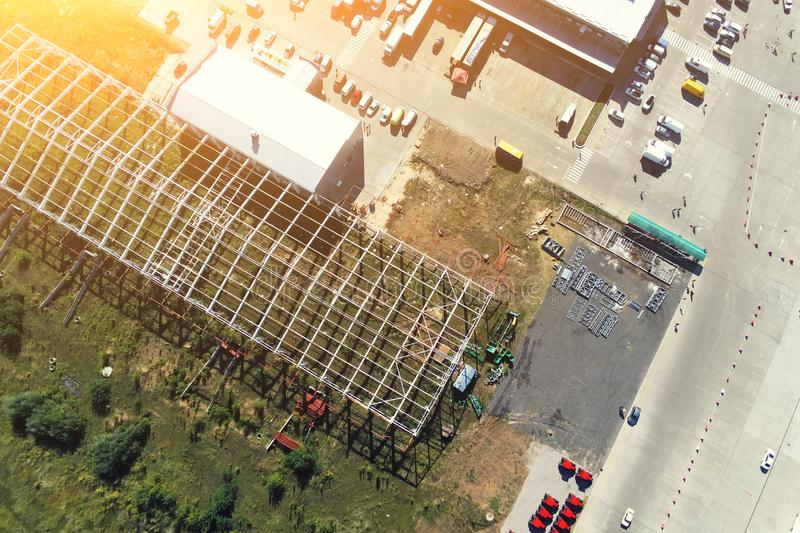 Steel frame construction of modern storage warehouse building at big city suburb. Aerial drone view from above royalty free stock photos