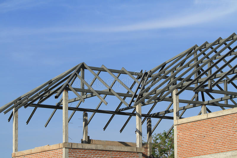 Steel frame of house roof. Under construction royalty free stock photography
