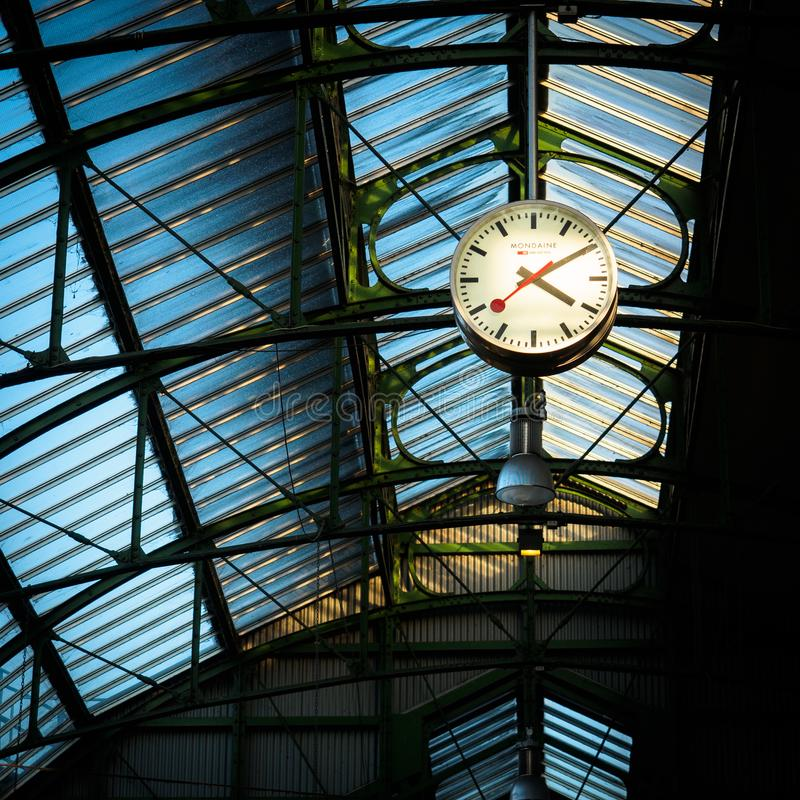 Steel framed roof at Borough Market with a clock. London, 2017. royalty free stock photos