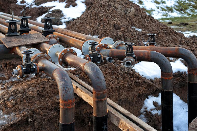 Pipes and valves at oil refinery royalty free stock images