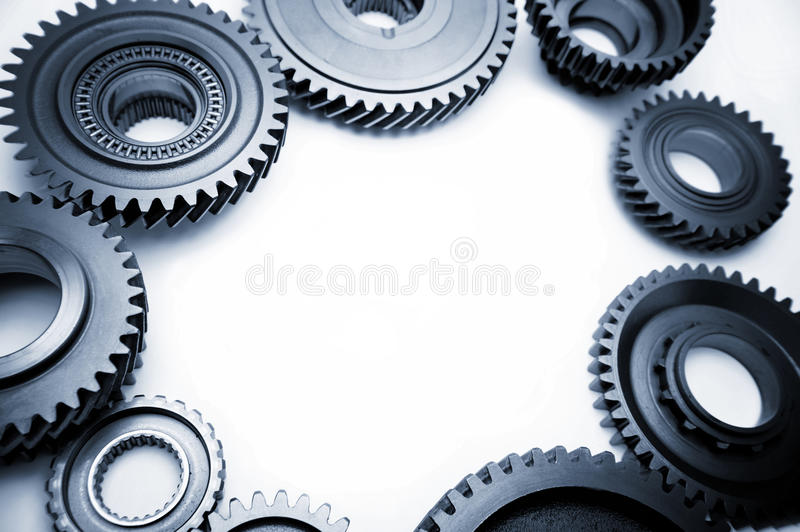 Steel gears. On plain background. Copy space stock photography