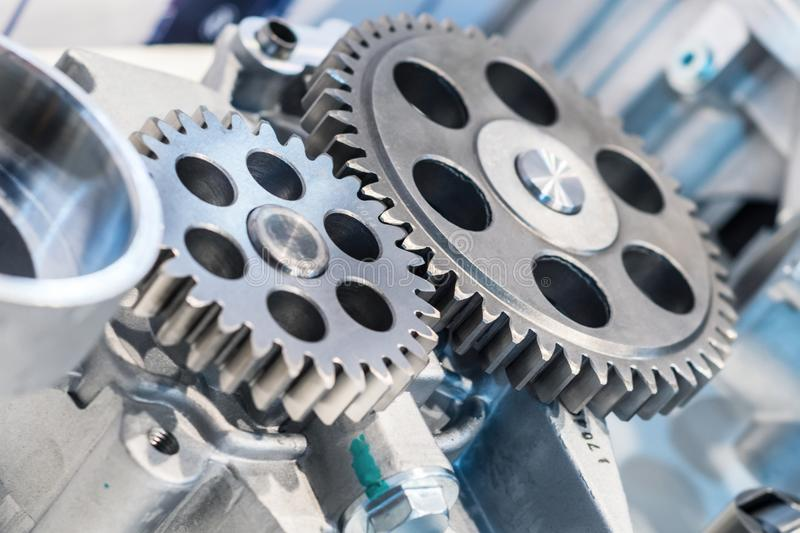 Steel cogwheels, spur gears. Steel gears and rolling bearing. Gear. Abstract industrial background stock photography