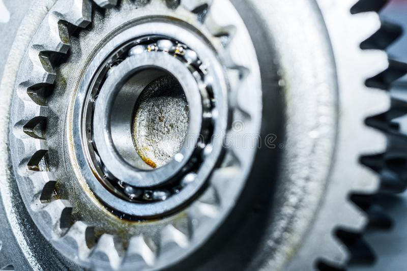 Steel gears and rolling bearing. Gear. Abstract industrial background stock photos