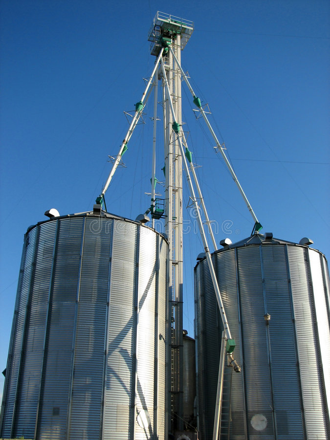 Steel grain bin and blue sky stock photography