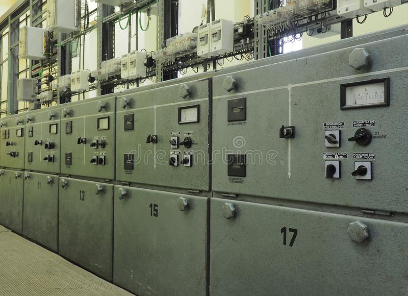 Row of electrical steel control panels stock photos