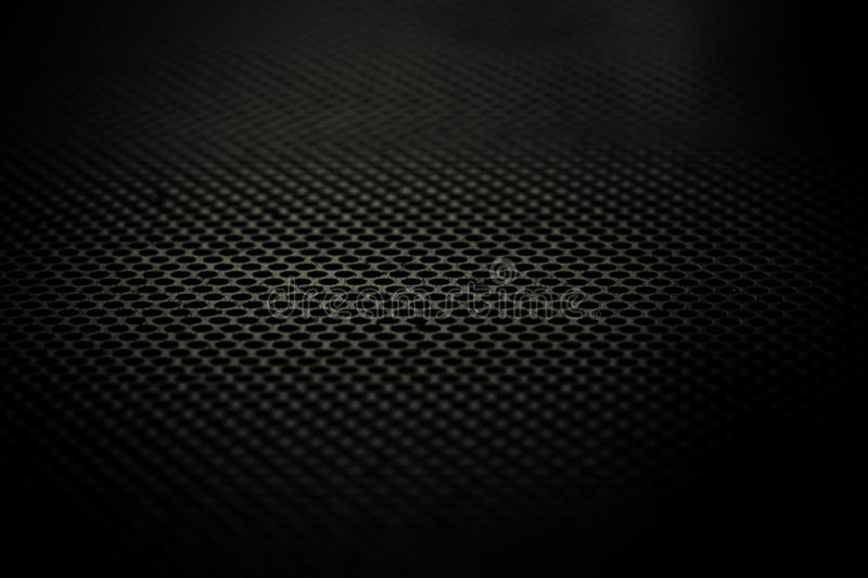 Steel grid. A steel grid with a narrow focus and low lighting royalty free stock photo