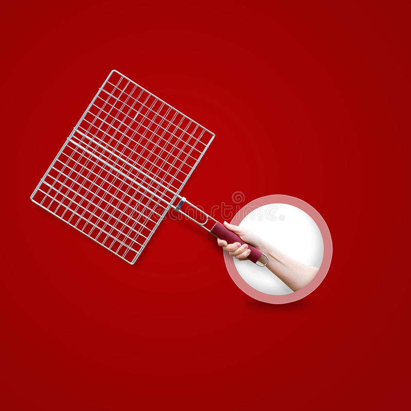Steel grid for grill in hand isolated . royalty free stock image