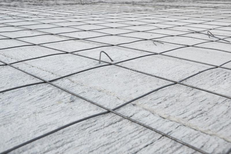 Steel grid placed on precast concrete floor. Ready for filling up with concrete, construction, reinforced, metal, industry, structure, iron, site, pouring, rod stock images