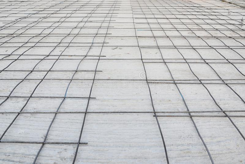 Steel grid placed on precast concrete floor. Ready for filling up with concrete, construction, reinforced, metal, industry, structure, iron, site, pouring, rod stock photo