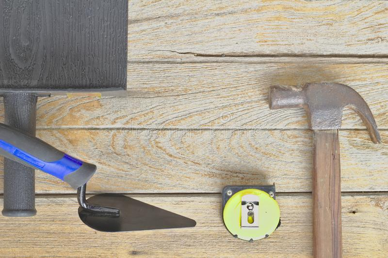 Steel hammer, wooden handle, meter tape.Brick wall tools Build a house wall Construction of new houses, royalty free stock photography