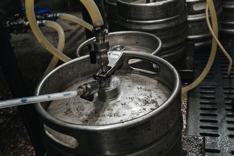 Steel industrial stack of beer kegs against. stock photography