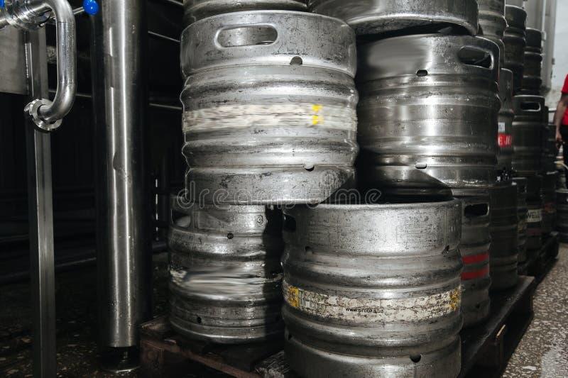 Steel industrial stack of beer kegs against. stock photos