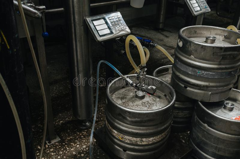 Steel industrial stack of beer kegs against. royalty free stock photo