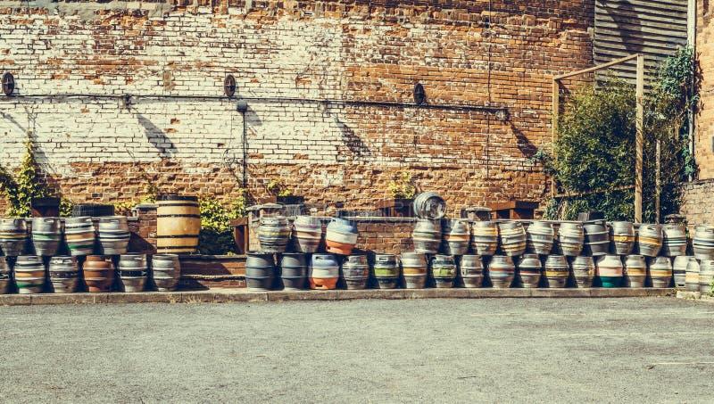 Steel kegs of beer in factory yard panoramic view. Steel kegs of beer in storage yard panoramic view stock photography