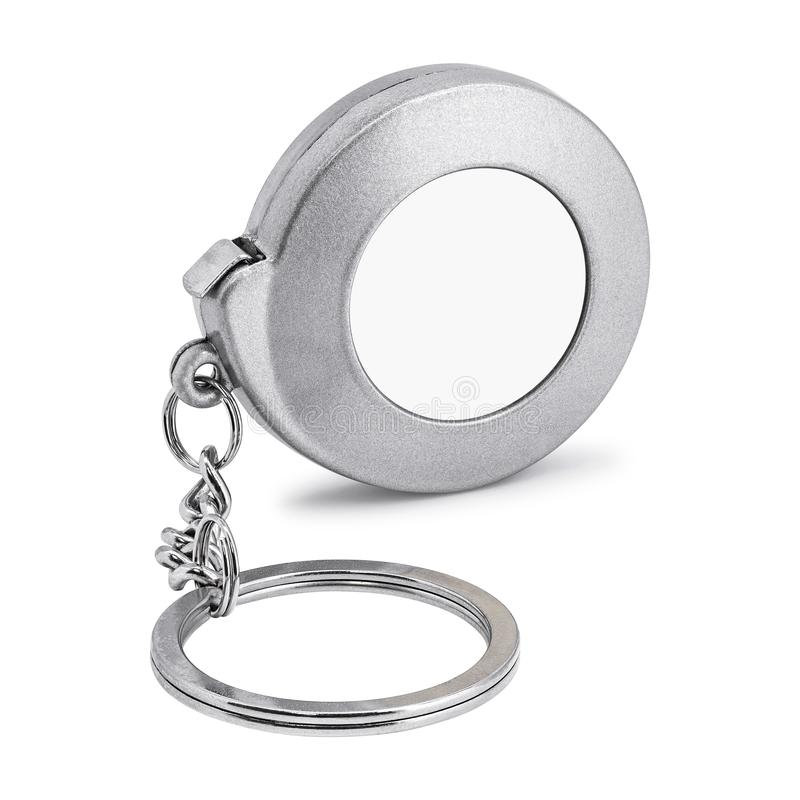 Steel key chain isolated on white background. Blank keyring in measuring tape concept.  Clipping path. Keyring royalty free stock photos
