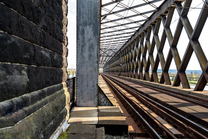 Steel, lattice structure of the railway bridge over the river, view along the tracks.  stock photo
