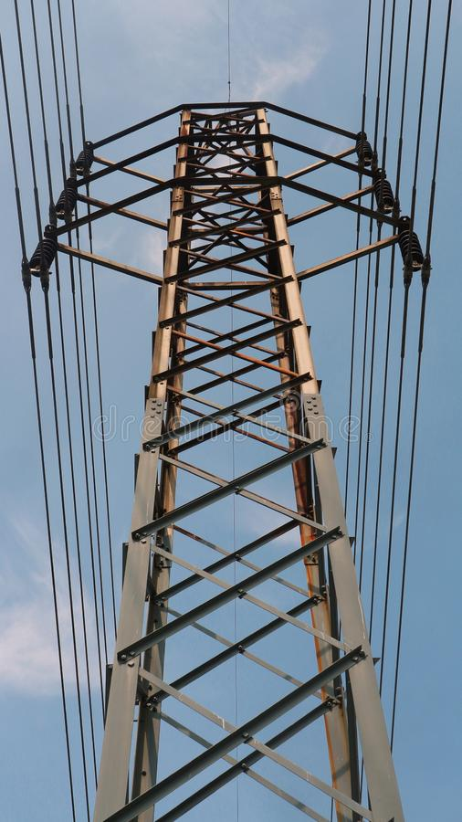 Steel lattice transmission line tower. Rises into blue sky royalty free stock image