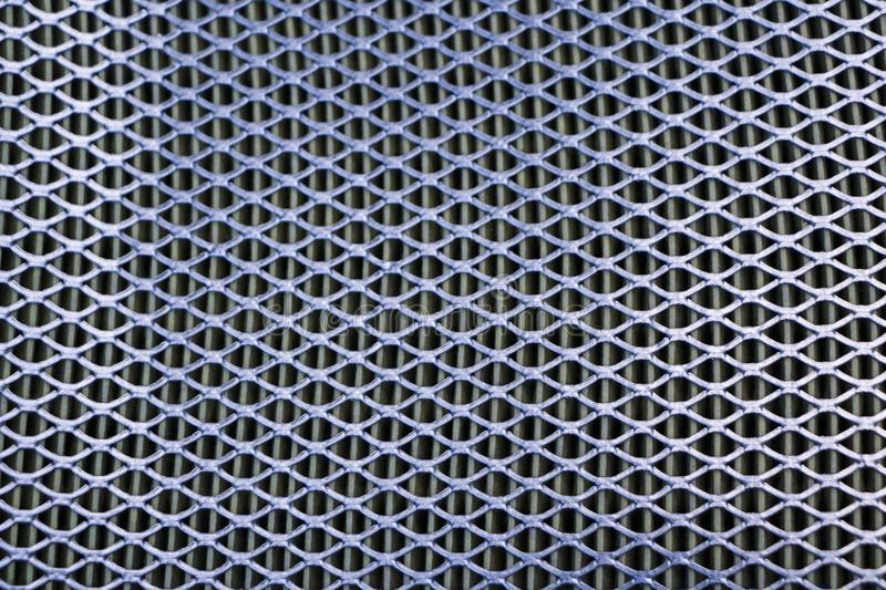 Steel mesh. Grid of car air filter. Metal grill texture of vehicle air filter. royalty free stock image
